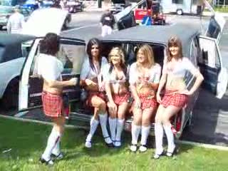 The Tilted Kilt Ladies at the back of a lambo door hearse  from:DotComd