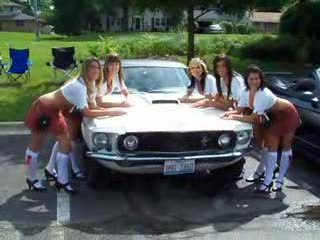 The Ladies Crowded around a classic mustang in need of paint... from:DotComd