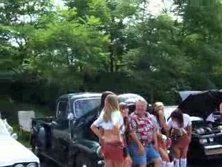 Add Comment To: The ladies around one of the classic trucks