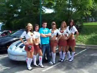 Tilted Kilt Ladies posing next to a silver and black Firebird from:DotComd