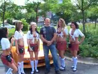 Tilted Kilt Ladies posing in front of a Rust Colored Acura NSX from:DotComd