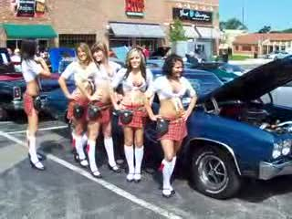 Tilted Kilt Ladies posing next to a blue Chevelle I think from:DotComd