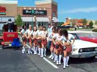 Tilted Kilt Ladies posing with a classic Mustang from:DotComd