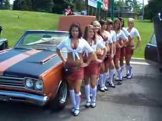 Add Comment To: The Ladies posing next to a rust colored GTO Convertible.