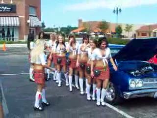Add Comment To: The ladies next to a Impala Stationwagon
