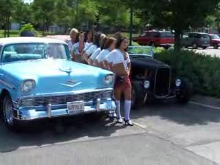 Tilted Kilt Ladies Posing between cars from:DotComd