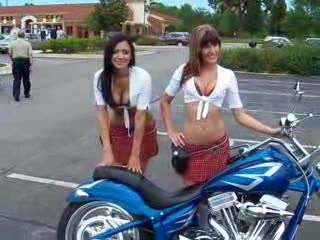 Mandi and Dee posing next to a bike from:DotComd
