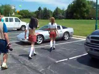 Dee and Mandi posing with a 90's Vette from:DotComd