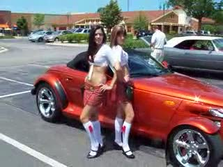 Mandi and Dee posing alone with the Prowler from:DotComd