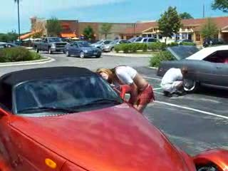 Add Comment To: Dee helping the owner put the top down on this prowler