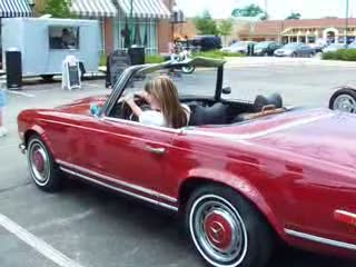 Dee  enjoying herself sitting in a 1969 Mercedes 280 SL from:DotComd