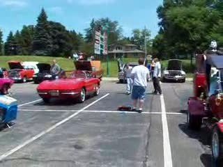 Add Comment To: Show attendees playing bags in the parking lot