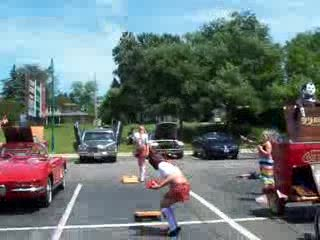 The TK Girls playing bags in the parking lot from:DotComd