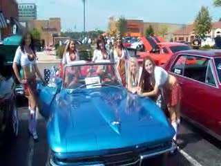 Posing in and around a blue Corvette from:DotComd