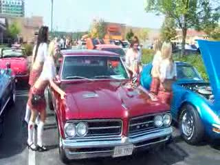 The Tilted Kilt Ladies posing with a Classic GTO from:DotComd